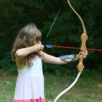girl shooting archery bow and arrow