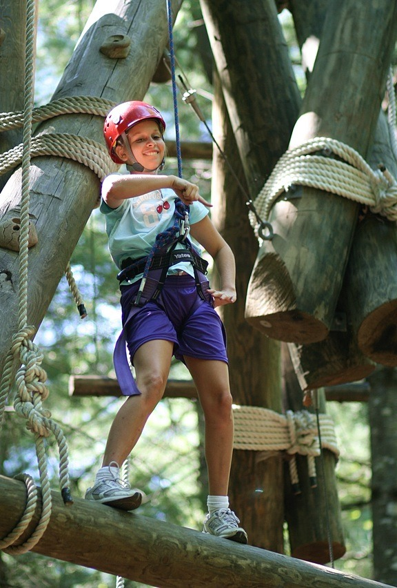 Youth girls climbing adventure ropes course
