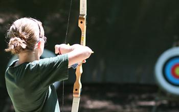 Archery camper pose