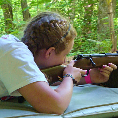 Camp Girl Shooting Rifle