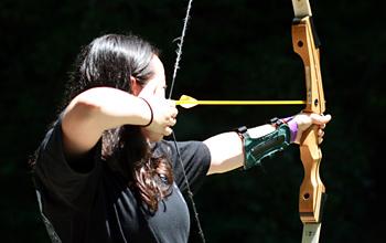 camp archery pose