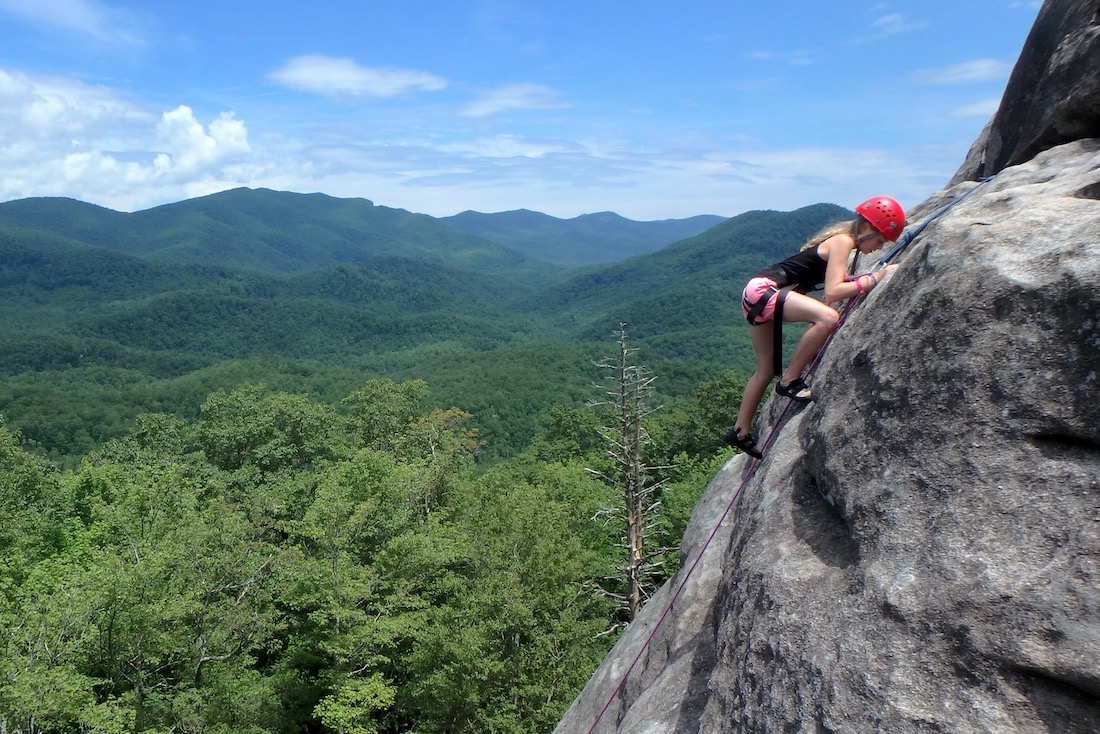 Girl camper rock climbing in NC