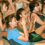 Camp Girls clapping while watching a skit