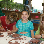 Kids building pottery at summer camp