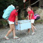 Girls Moving Trunks into Summer Camp