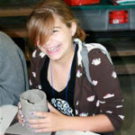Rockbrook Girls Smiles at Pottery Activity