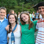 Girls at summer camp square dance