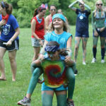 Camp girls playing games and relays