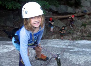 Rock climbing girl at summer camp