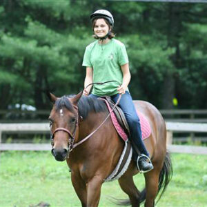 Girl equestrian camp horse riding