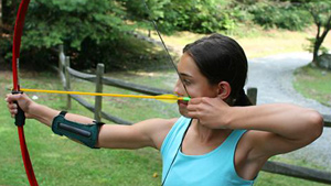 Camp girl archer shooting archery