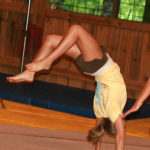 gymnastic camps girls flipping