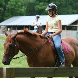 Camp girl riding horse back