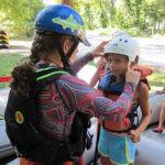 Rockbrook camper girl ready for whitewater rafting