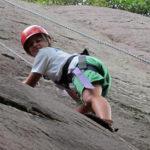 Summer camp girls rock climbing