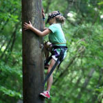 High ropes course tower camp climber