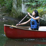 kids canoeing at summer camp
