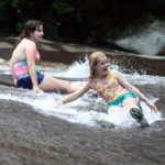 Campers Children sliding rock