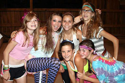 Camper girls dancing and dressed to the 1980s