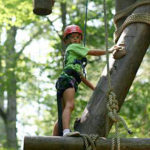 girl summer camp ropes course climber