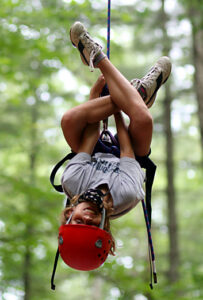 Kids learning to rock climb while at camp