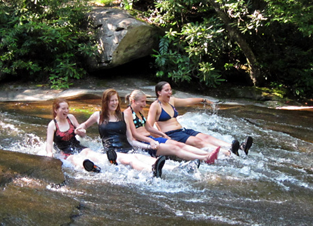 Children swimming in nature