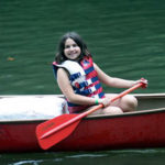 Learning to canoe while at summer camp