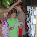 Girls receiving mail at summer camp