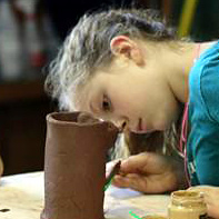 kid makes ceramics project at summer camp