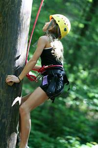 girl climbing summer camp
