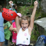 child rock climber at summer camp