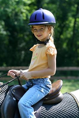 child horseback riding