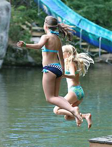 Camp girls jumping in the lake