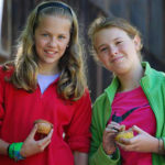 girls eating muffins at summer camp