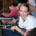 Girls rifle shooting at summer camp