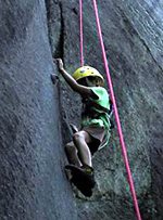 Camp kid rock climbing