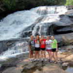 Girls hiking by the waterfalls
