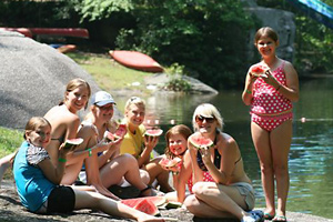 Campers enjoy a watermelon break