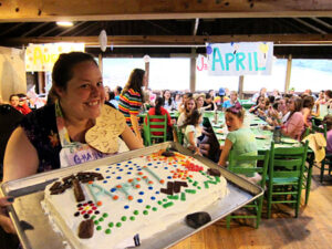Birthday cake and excited camp girls