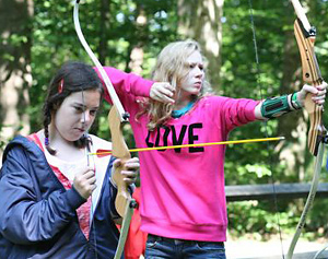 girls shooting archery at summer camp
