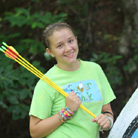 Learning archery and arrows at summer camp
