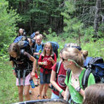 Girls going backpacking at summer camp
