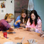 Girls making ceramics at summer camp