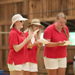 Summer camp staff members singing a song