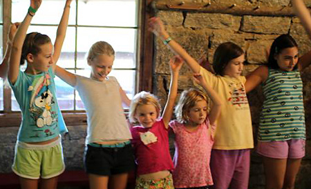 girls dancing together at summer camp