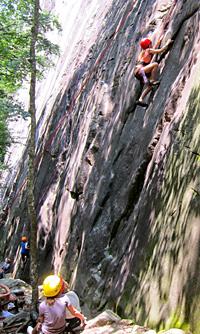 Kid rock climbing at Cedar