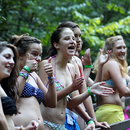 girls cheering their friends on sliding rock