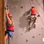girls climbing wall in the gym