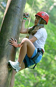 Girl climbing high ropes course