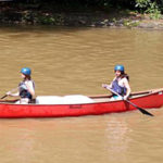 Girl Camp lake canoe activity